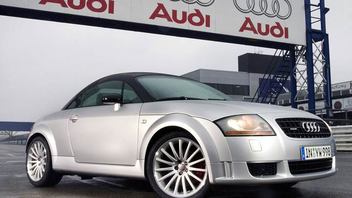 Side Pose Of 2005 Audi TT Quattro Sport In White N HeadLights On
